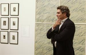 Real estate developer Jeff Soffer looks at artwork on display during the Art Basel Miami Beach Vernissage in Miami Beach, Fla. Wednesday, Dec. 2, 2009.