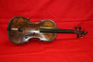 A violin believed to be the one played by Titanic bandmaster Wallace Hartley will go up for auction tomorrow.