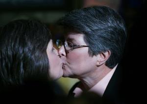 Cindy Meneghin, right, kisses her partner Maureen Kilian, both from Butler, NJ, during a rally at Garden State Equality in Montclair, NJ, Friday, Sept. 27, 2013.