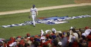 Los Angeles Dodgers starting pitcher Clayton Kershaw walks back to the dugout after the third inning of Game 6 of the National League baseball championship series against the St. Louis Cardinals Friday, Oct. 18, 2013, in St. Louis. The Cardinals scored four runs in the inning.