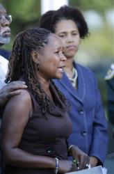 Lillie Danzy, left, mother of escaped inmate Charles Walker, standing next to attorney Rhonda Henderson, right, makes a plea for her son to turn himself in to authorities during a news conference at the Orange County Sheriff's Office in Orlando, Fla., Saturday, Oct. 19, 2013. Joseph Jenkins and Charles Walker,...