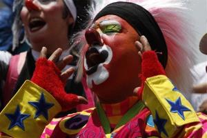 A clown sings during the annual clown pilgrimage to the Basilica of Guadalupe in  Mexico City,in this July 24, 2013, file photo.