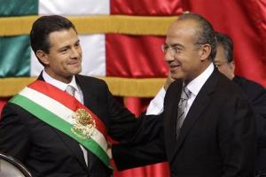 Mexico's incoming President, Enrique Pena Nieto, left, smiles as he stands with outgoing President Felipe Calderon during the inauguration ceremony at the National Congress in Mexico City.