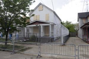 A 10-foot chain link fence surrounds the home of Ariel Castro in Cleveland in this May 14, 2013 file photo.