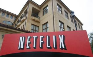 FILE - This Jan. 29, 2010, file photo, shows the company logo and view of Netflix headquarters in Los Gatos, Calif. Netflix reports quarterly earnings on Monday, Oct. 21, 2013.