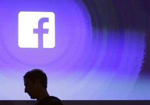 Facebook CEO Mark Zuckerberg walks at the company's headquarters in Menlo Park, Calif.
