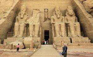 A tourist takes photographs of the Great Temple of Ramses II in Abu Simbel, Egypt. Ramses II led as the region approached Late Bronze Age disaster.