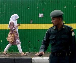 Brunei will join Aceh province, Indonesia, in implementing Islamic sharia law.