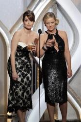 This image released by NBC shows co-hosts Tina Fey, left, and Amy Poehler during the 70th Annual Golden Globe Awards at the Beverly Hilton Hotel on Jan. 13, 2013, in Beverly Hills, Calif.