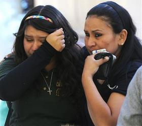 A tearful Michelle Hernandez, left, is led away following a shooting at Sparks Middle School in Sparks, Nev.