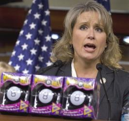 Rep. Renee Ellmers, R-NC, stands behind a prop of 'Magic 8 Balls' during a news conference held by Republican freshmen on Capitol Hill in October, 2011.