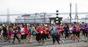 Competitors pass the Bay Bridge during the annual Nike Women's Marathon in San Francisco.