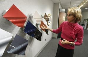 Jane Harrington, PPG's manager of automotive color styling shows off the company's color palette in Troy, Michigan.