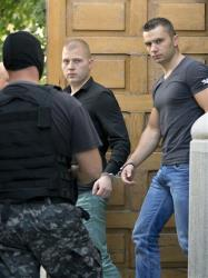 Eugen Darie, center, and Radu Dogaru, right, two suspects charged with stealing paintings from a Dutch museum.