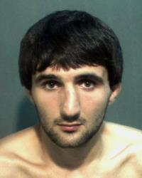 This May 4, 2013 file police mug provided by the Orange County Corrections Department in Orlando, Fla., shows Ibragim Todashev after his arrest for aggravated battery in Orlando.