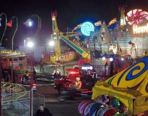 Emergency crews respond to the scene where a ride malfunctioned at the North Carolina State Fair, Thursday, Oct. 24, 2013 in Raleigh, NC.
