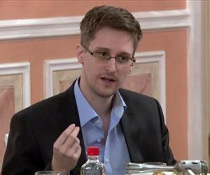 In this file image made from video released by WikiLeaks, Oct. 11, 2013, former NSA systems analyst Edward Snowden speaks during a presentation ceremony for the Sam Adams Award in Moscow, Russia.