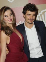 Miranda Kerr, left, and Orlando Bloom arrive at the InStyle and Warner Bros. Golden Globe After Party at the Beverly Hilton Hotel on Sunday Jan. 13, 2013, in Beverly Hills, Calif.