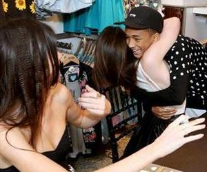 From right, Jaden Smith surprises Kylie and Kendall Jenner at the launch of the exclusive Kendall & Kylie summer collection at PacSun in Santa Monica, Calif. on Friday, May 10, 2013.