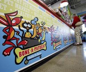 A customer pays for her purchases at the Bone-A-Patreat store in Des Moines, Iowa.