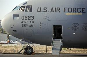 Members of the U.S. Air Force's 437th Airlift Wing perform a pre-flight check in this file photo.