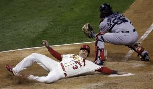 St. Louis Cardinals' Carlos Beltran slides safely past Boston Red Sox catcher Jarrod Saltalamacchia during the seventh inning of Game 3 of baseball's World Series Saturday, Oct. 26, 2013, in St. Louis. Beltran scored from second on a double by Matt Holliday.