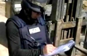 A chemical weapons expert works at a chemical weapons plant at an unknown location in Syria.