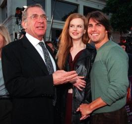 In this July 13, 1999 file photo, Tom Cruise and Nicole Kidman, who star in the film Eyes Wide Shut, mingle with their co-star Sydney Pollack, left, at the premiere of the film, in Los Angeles.