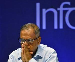 Infosys Executive Chairman N. R. Narayana Murthy listens to shareholders during the company's 32th Annual General Meeting in Bangalore, India, June 15, 2013.