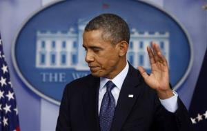 President Obama gestures as he leaves after speaking about the the budget and the government shutdown on Oct. 8.