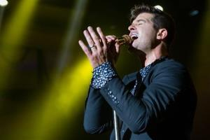 Robin Thicke performs onstage at the 97.1 AMP Radio Halloween Masquerade concert at the Palladium on Saturday, Oct. 26, 2013 in Los Angeles.