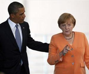 In this June 19, 2013, file photo, President Barack Obama and German Chancellor Angela Merkel arrive for a news conference at the chancellery in Berlin.
