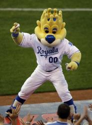 Kansas City Royals mascot Sluggerrr throws hot dogs into the crowd during a game in 2009.