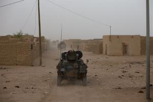 In this July 28, 2013 file photo, a French military convoy drives through a neighborhood of Kidal in northern Mali.