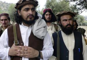 In this Oct. 4, 2009 file photo, Pakistani Taliban chief Hakimullah Mehsud, left, is seen during a meeting with media near the Afghanistan border.
