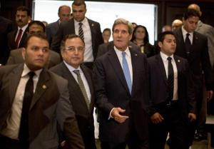 US Secretary of State John Kerry walks with Egypt's Foreign Minister Nabil Fahmy, second left, to their joint press conference in Cairo, Sunday, Nov. 3, 2013.