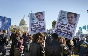 Demonstrators rally at the US Capitol to protest spying on Americans by the National Security Agency, Saturday, October 26, 2013.