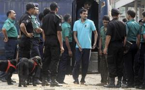 Handcuffed border guards arrive at a special court in Dhaka, Bangladesh, Tuesday, Nov. 5, 2013.