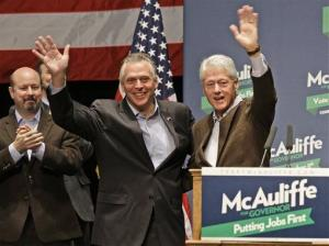 Former President Bill Clinton, right, waves to the crowd along with Virginia Democratic gubernatorial candidate, Terry McAuliffe during a rally in Charlottesville, Va., Wednesday, Oct. 30, 2013.