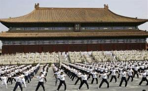 Thousands of people perform exercises in the Forbidden City to kick off an official campaign to urge workers to take daily workouts in Beijing in 2010.
