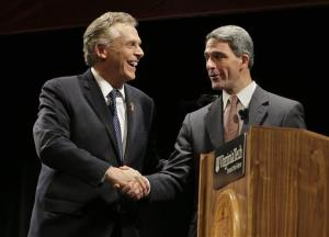 Democratic gubernatorial candidate Terry McAuliffe, left, shakes the hand of  Republican challenger Virginia Attorney General Ken Cuccinelli, right, after a debate at Virginia Tech last month.