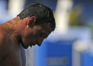 Ryan Lochte of the United States looks down as he leaves the pool after finishing the Men's 100m butterfly final at the FINA Swimming World Championships in Barcelona, Spain in August this year.