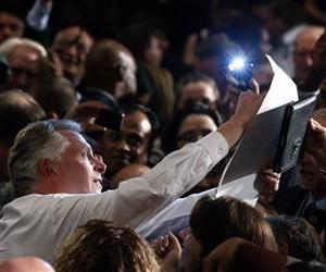 Virginia Democratic Governor-elect Terry McAuliffe, left, signs an autograph as he greets supporters during an election night party, Tuesday, Nov. 5, 2013, in Tysons Corner, Va.