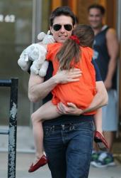 This Tuesday July 17, 2012 photo shows actor Tom Cruise and daughter Suri Cruise leaving Chelsea Piers in New York.