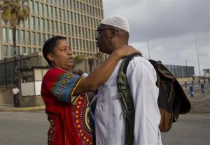 William Potts says goodbye to his wife before American officials escort him to the airport in Havana, Cuba.