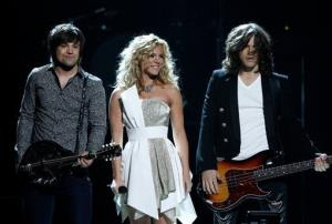 The Band Perry, from left, Neil, Kimberly and Reid Perry perform at the 47th annual CMAs on Wednesday, Nov. 6, 2013, in Nashville, Tenn.