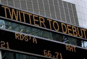 News about Twitter's public stock debut is displayed on a screen in Times Square, New York, Thursday, Nov. 7, 2013.