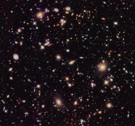 This image provided by NASA and taken by the Hubble Space Telescope shows previously unseen early galaxies.