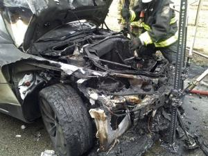 In this Nov. 6 photo provided by the Tennessee Highway Patrol, emergency workers respond to a fire on a Tesla Model S electric car in Smyrna, Tenn.