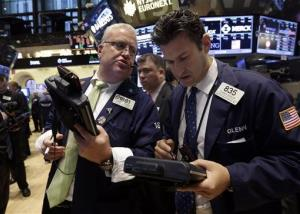 Traders converse on the floor of the New York Stock Exchange Friday, Nov. 8, 2013.